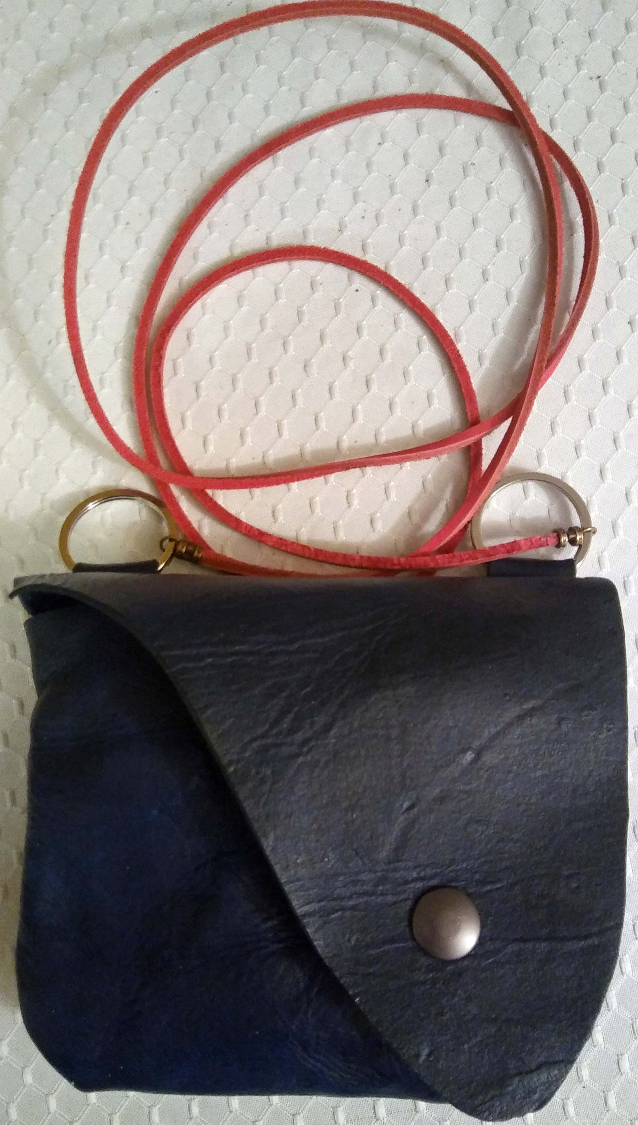 Leather-bag with red leather cord