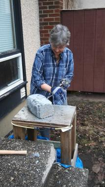 Sheree carving in yard pic 1